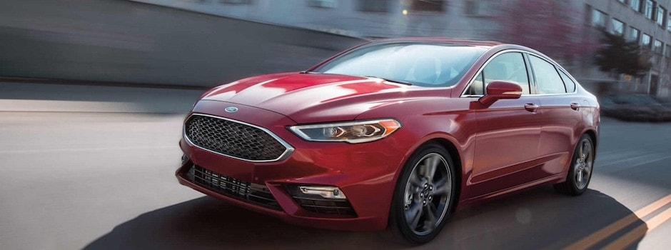 A red 2018 Ford Fusion driving down the road