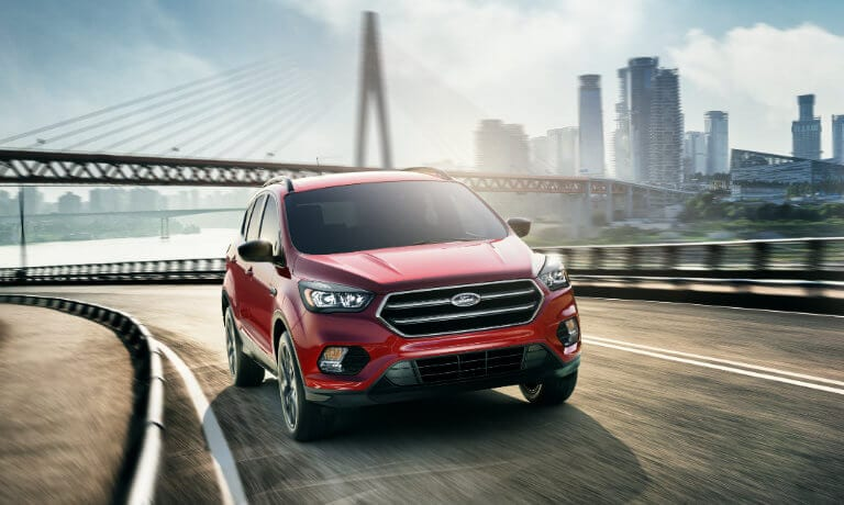 2019 Red Ford Escape Driving Out of the City