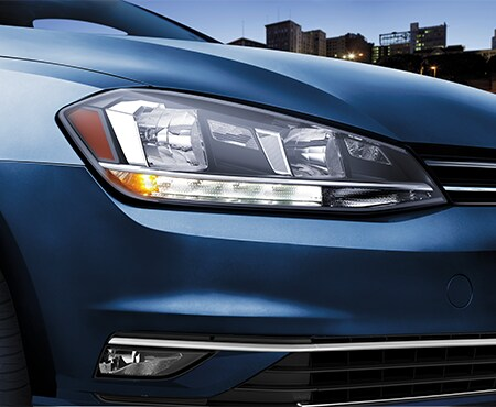 Close-Up of Headlights on Blue Volkswagen Golf
