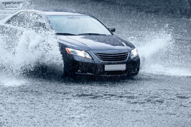 car driving in flood