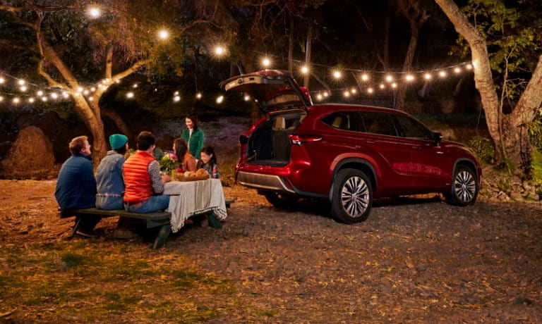 Family having a picnic in the woods with 2020 Toyota Highlander