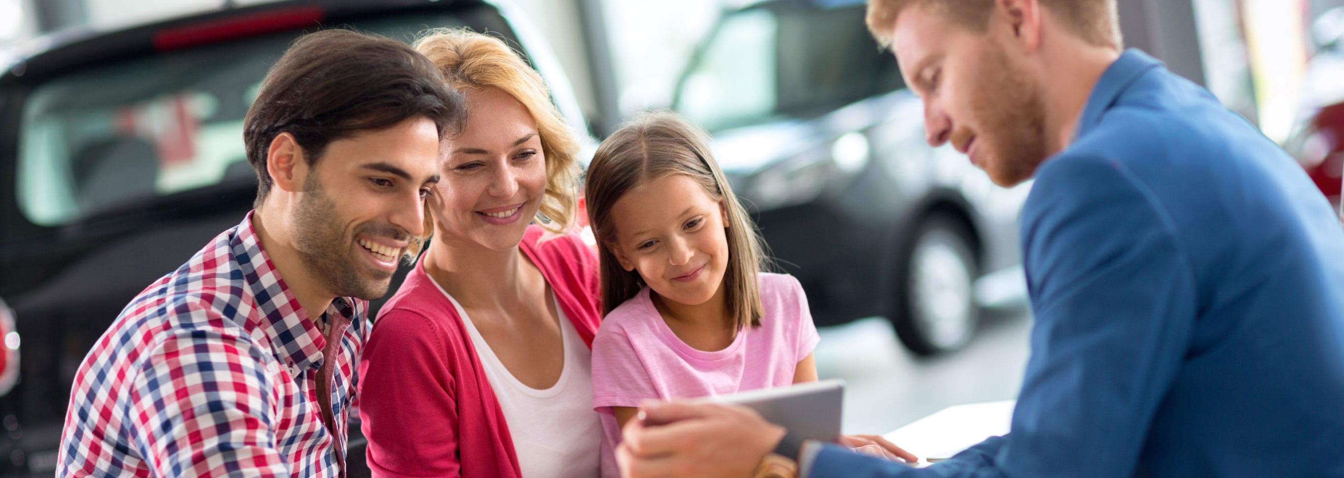 Family Going Over Mitsubishi Financing Options