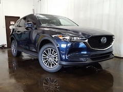 New 2021 Mazda Mazda CX-5 Touring SUV JM3KFBCM5M1307799 for sale in Cuyahoga Falls, OH