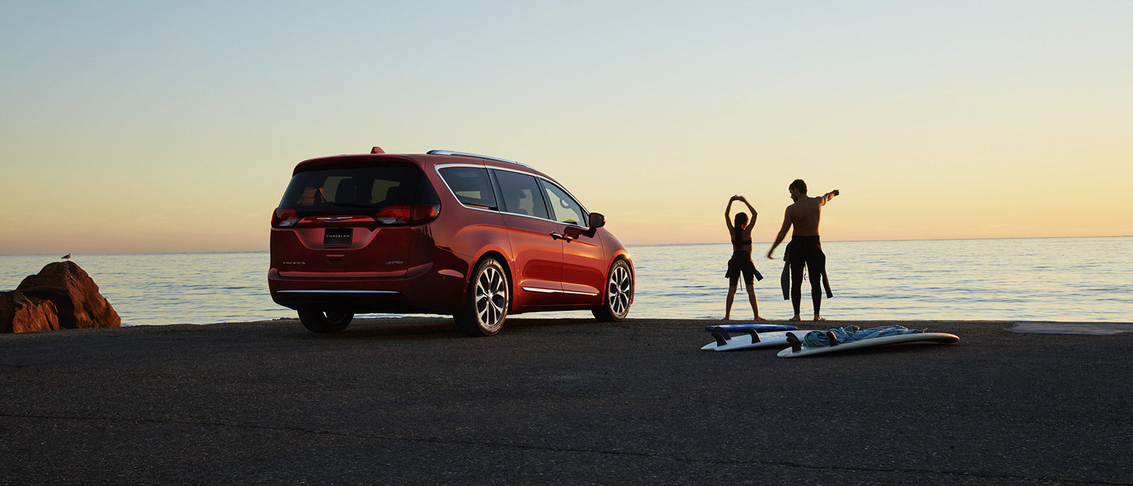 Red Pacifica Rear Exterior Surfing