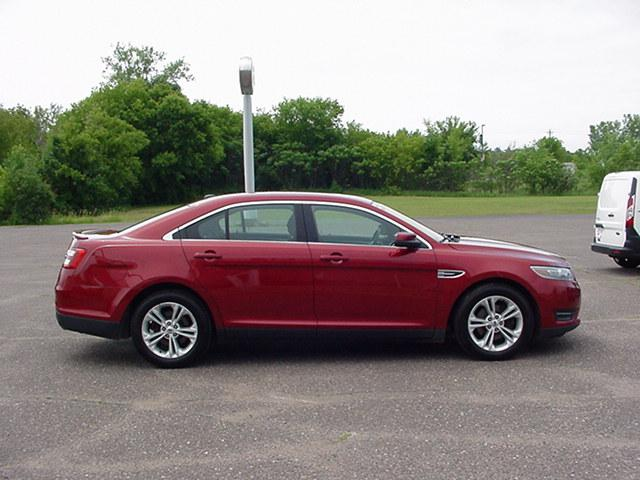 Used 2014 Ford Taurus SEL with VIN 1FAHP2E84EG137228 for sale in Pine City, Minnesota