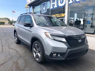 New 2020 Honda Passport Touring AWD SUV 5FNYF8H92LB011462 in Port Huron, MI