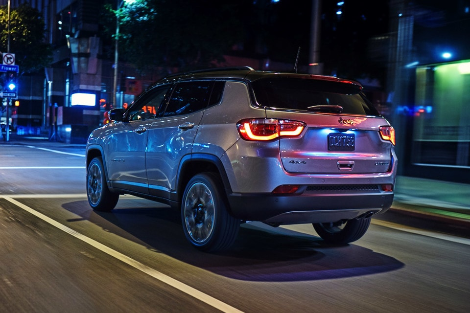 2021 Jeep Compass Driving Through City At Night
