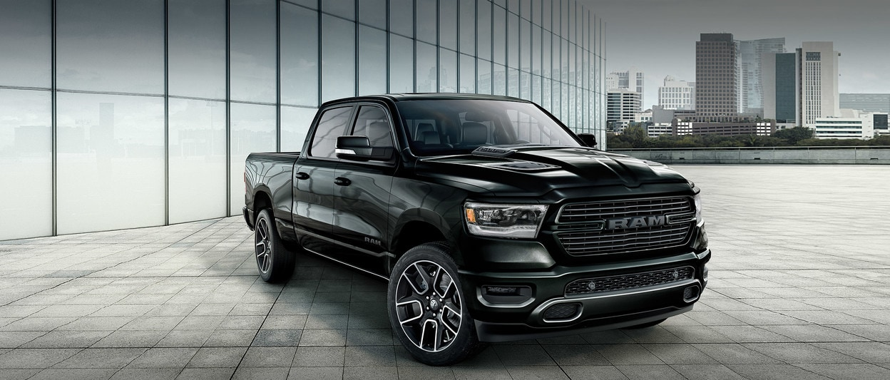 2020 Ram 1500 Black Sport, Parked With City Skyline