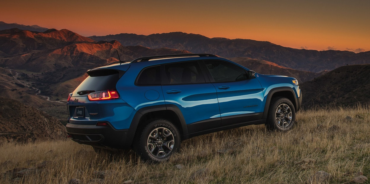 2021 Jeep Cherokee Blue Park On Hill During Sunset