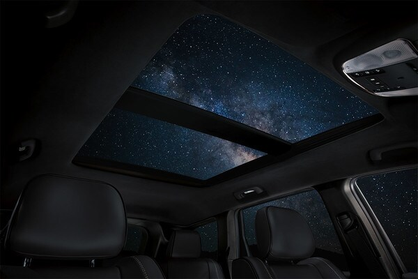 2020 Jeep Grand Cherokee Interior With Dual Pane Roof With Starts Showing At Night