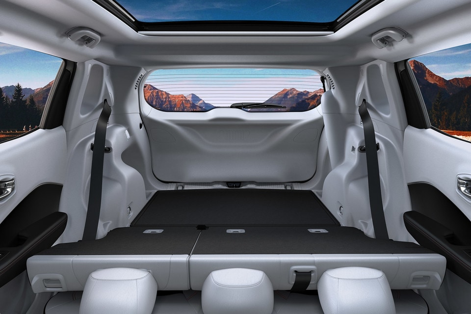 2020 Jeep Compass Interior With Seats Folded with Mountains in he background