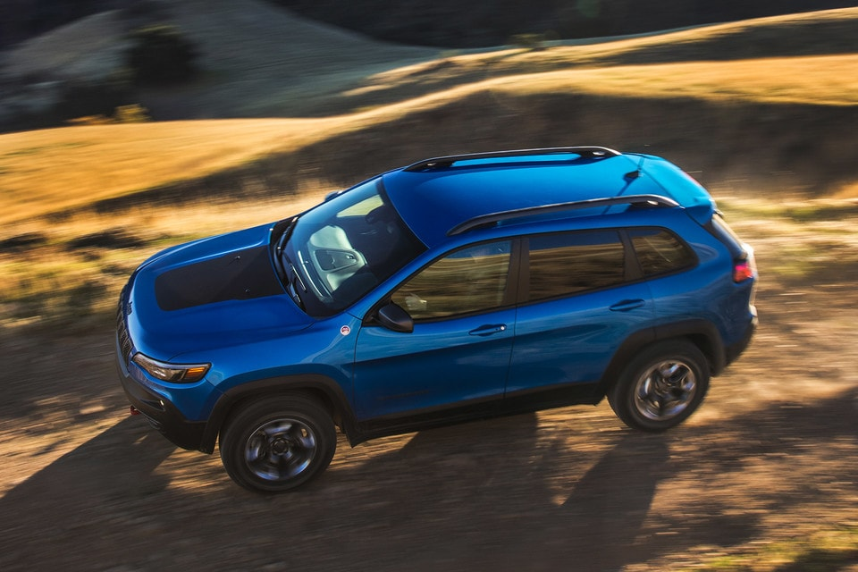 Blue Jeep Cherokee Trailhawk Driving In Desert
