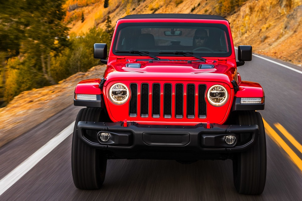 Red 2020 Jeep Wrangler Driving On Highway Mountain.jpg