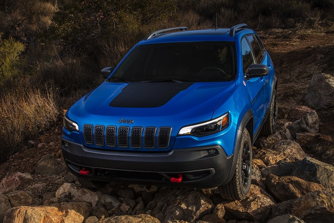 2020 Jeep Cherokee in Blue driving off-road