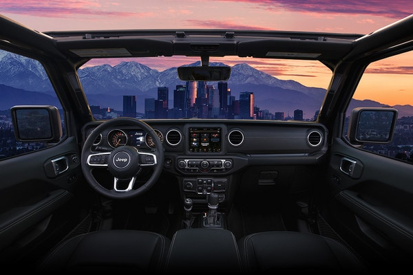 2020 Jeep Gladiator Interior Design With City Skyline During Sunset