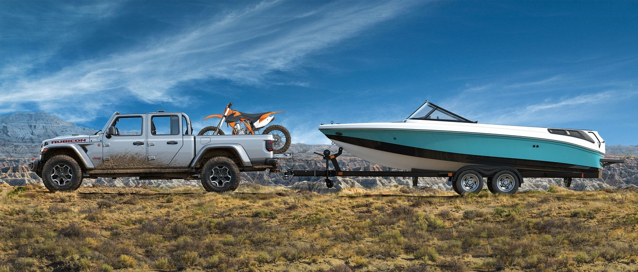 2020 Jeep Gladiator Rubicon Towing a Boat with a Bike on the truck bed