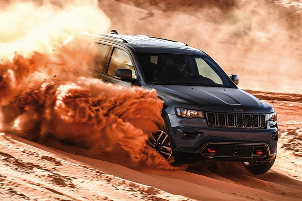 2020 Jeep Grand Cherokee capability feature grey drifting insand