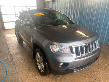 Featured used 2013 Jeep Grand Cherokee Overland SUV for sale in Melfort, SK