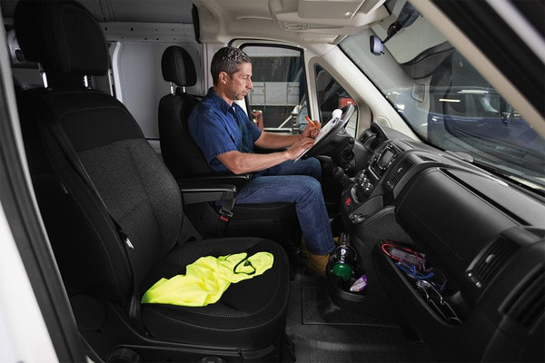 2020 Ram ProMaster 1500  With A Man Sitting In The Front Seat Filling Paperwork