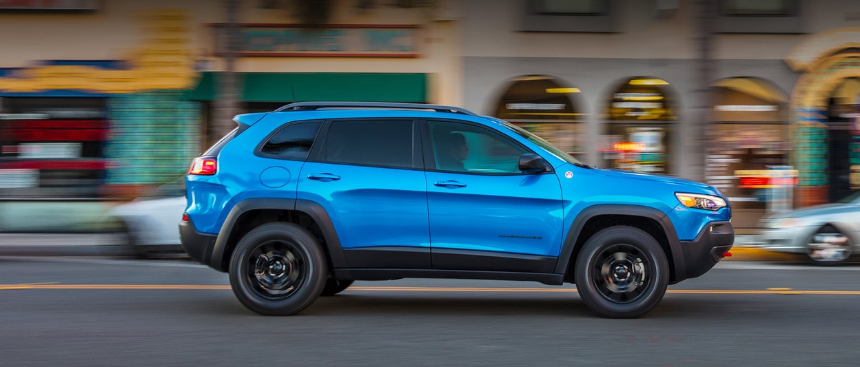 2020 Jeep Cherokee blue driving in city
