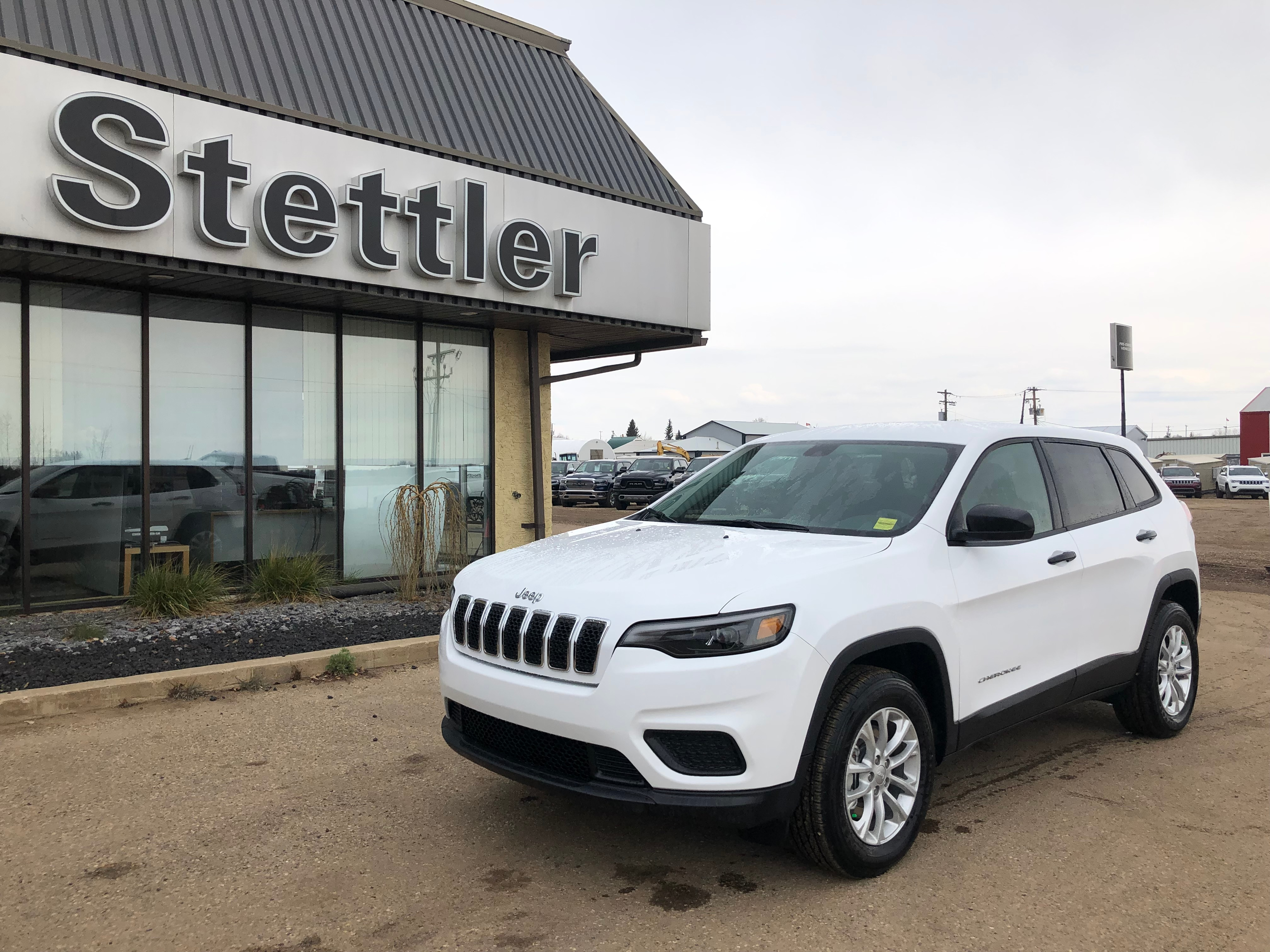 Featured pre-owned  2019 Jeep New Cherokee Sport SUV for sale in Stettler, AB