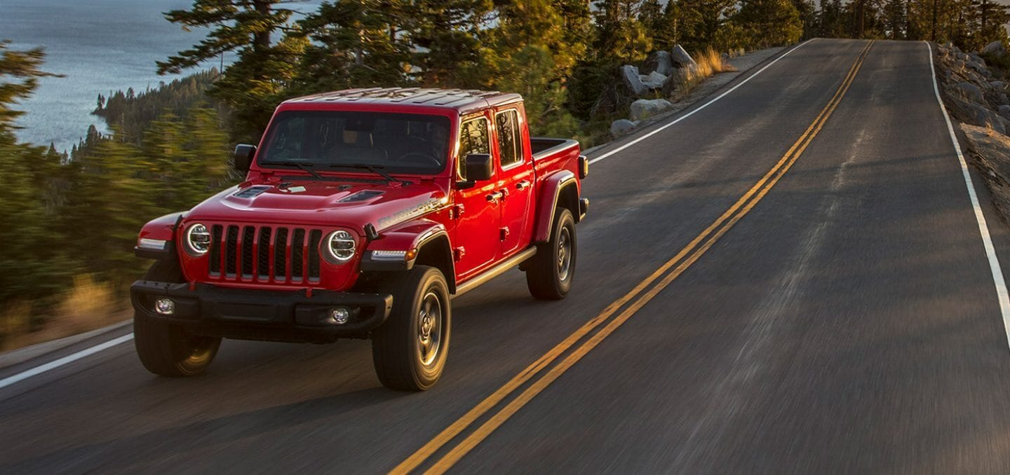 2021 Red Jeep Gladiator Driving On Road