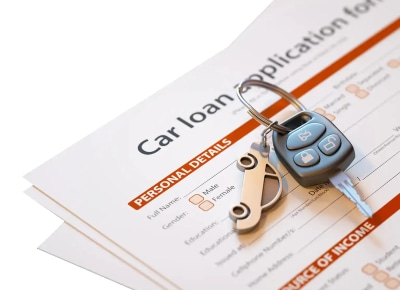 Car Loan Application With Car Keys Laying On It