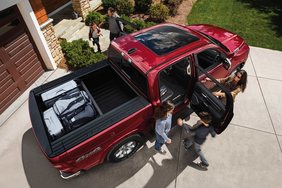 2020 Ram 1500 top view of family loading pickup truck