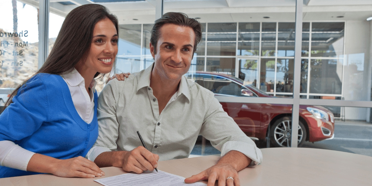 Couple applying for auto financing through AutoNation