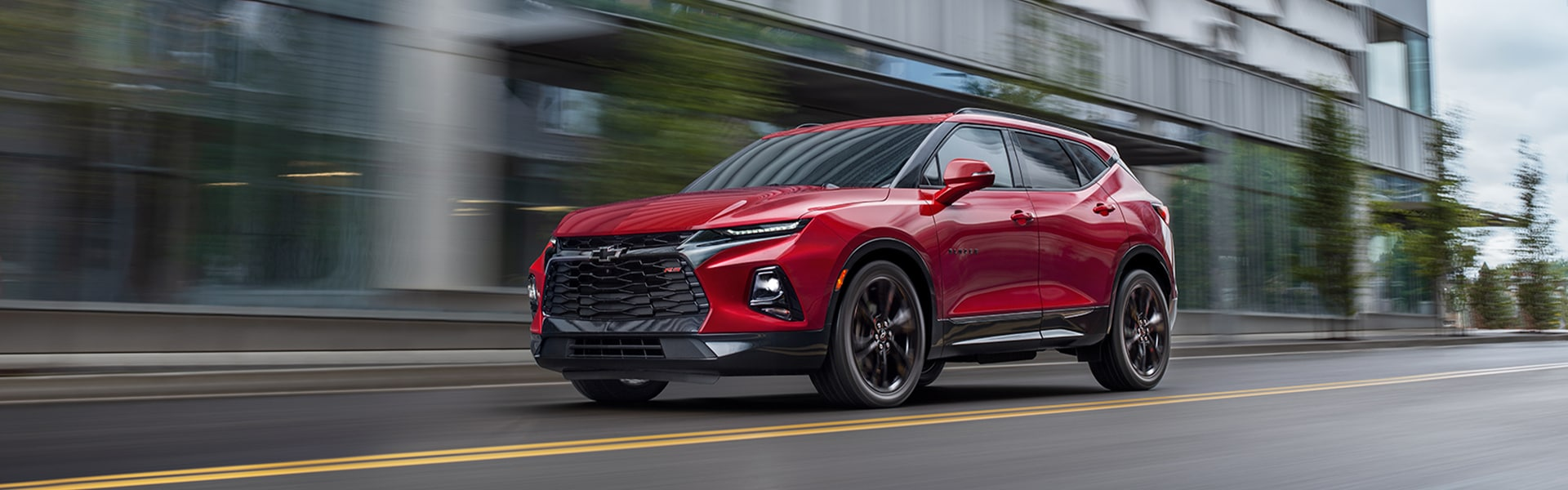 Chevrolet of New Bern is a Car Dealership in New Bern near Bogue NC | 2020 Chevrolet Blazer driving on city street