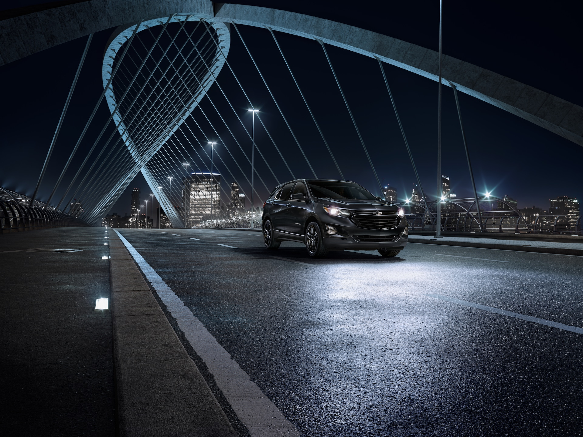Chevrolet of New Bern is a Car Dealership in New Bern near Bogue NC | 2020 Chevrolet Equinox on bridge at night