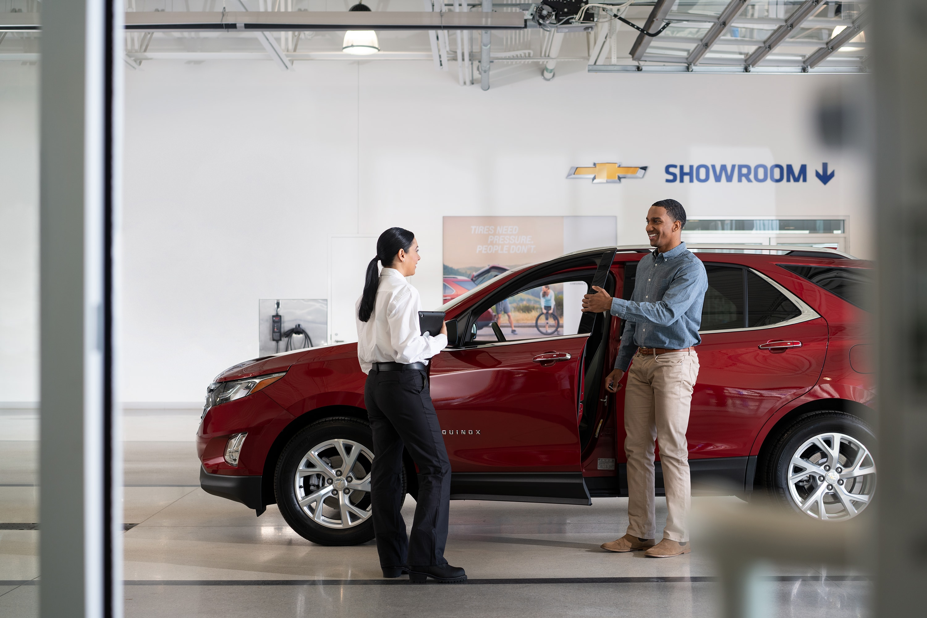 Chevrolet of New Bern is a Car Dealership in New Bern near Bogue NC | Chevrolet Service Advisor meeting with customer