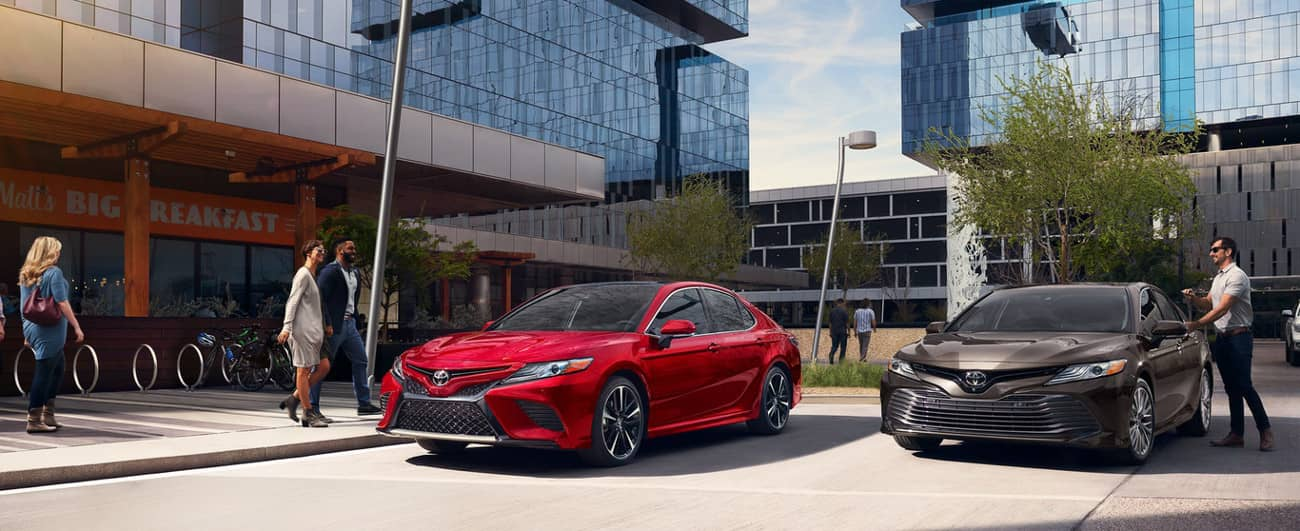 2019 Toyota Camry in Brownstone and Supersonic Red colors