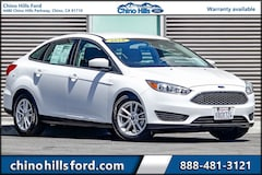 Pre-Owned 2018 Ford Focus SE Sedan 1FADP3F23JL250670 for sale in Chino, CA