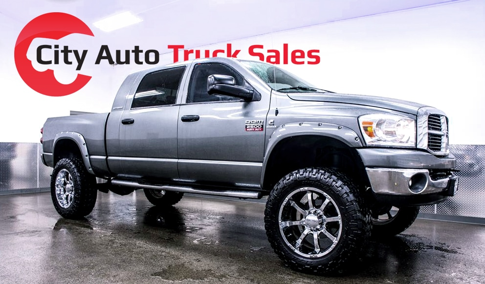 a photo of a customized, lifted truck in the City Auto Truck Sales wash bay