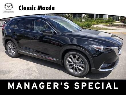 Featured new  2021 Mazda CX-9 Grand Touring SUV for sale in Orlando, FL