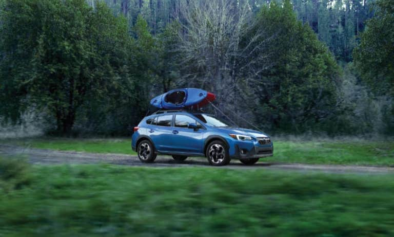 2021 Blue Subaru Crosstrek Hauling Two Canoes on the Roof