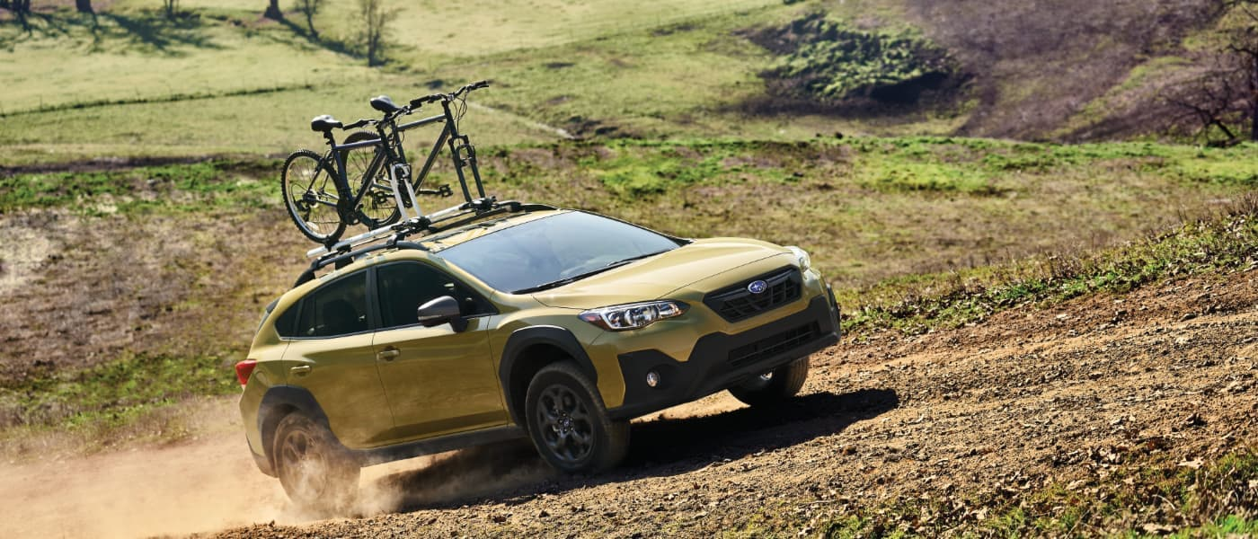 2021 Green Subaru Crosstrek Hauling Bicycles Off-Road