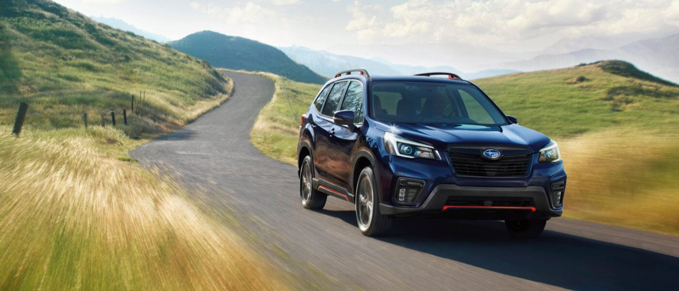 2021 Blue Subaru Forester Driving on Rolling Green Hills