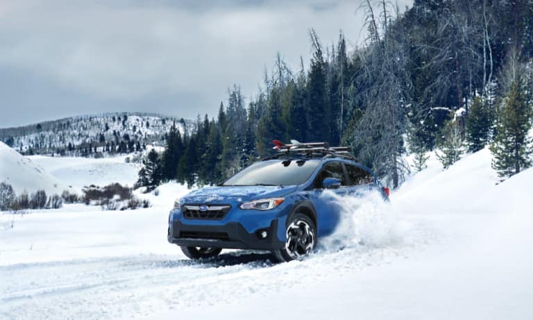 2021 Blue Subaru Crosstrek Driving in Snow