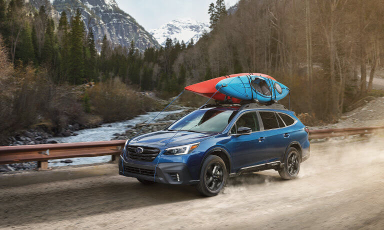 2021 Subaru Outback with a boat on top