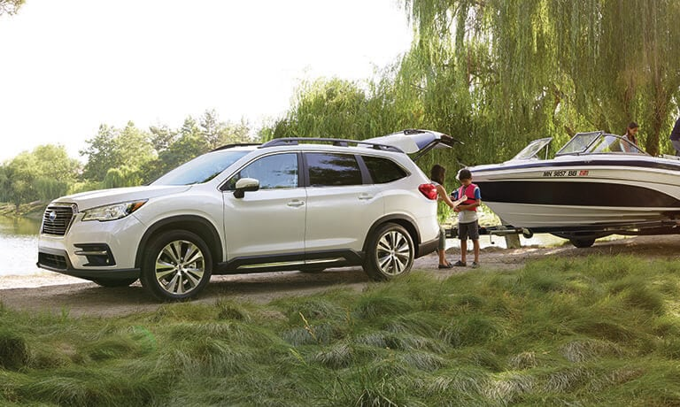2021 Subaru Ascent towing a boat by the lake