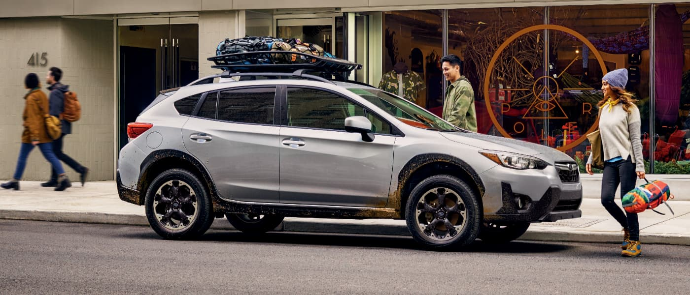 A Couple Packing up a Silver 2021 Subaru Crosstrek for Camping