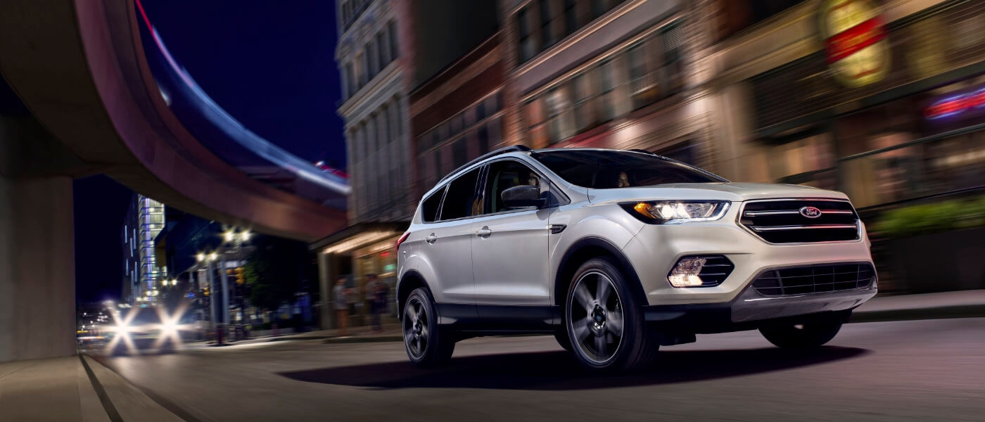 2019 Ford Escape driving through city at night