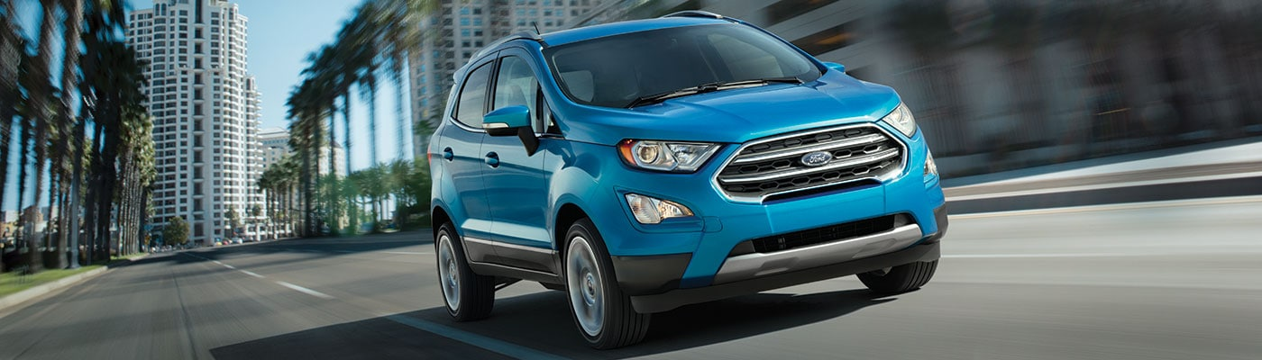 Blue 2019 Ford EcoSport driving down street