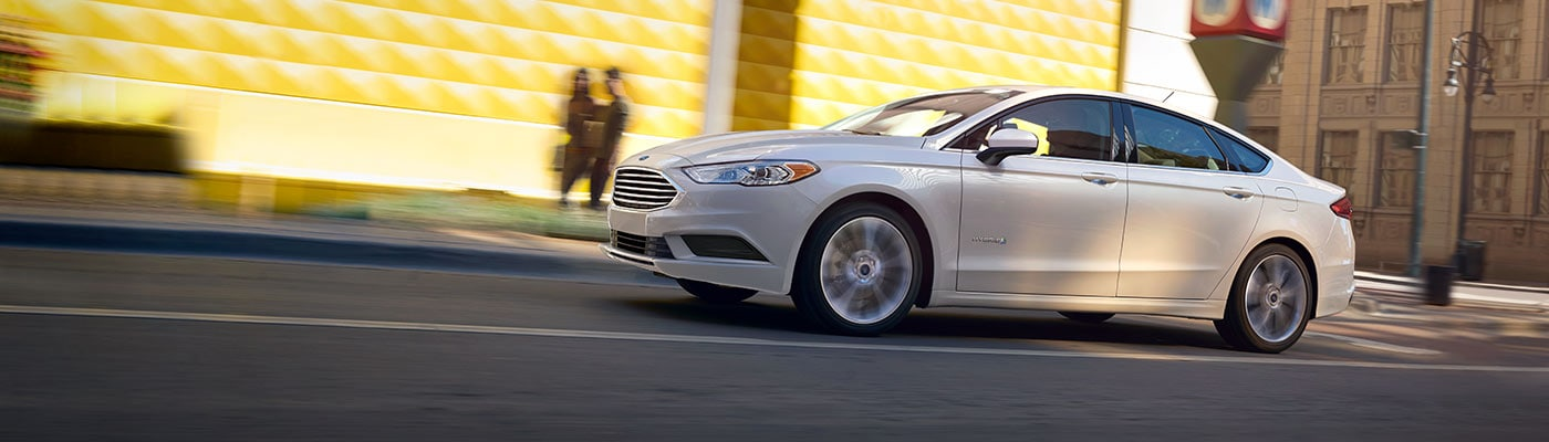 2019 Ford Fusion driving down street