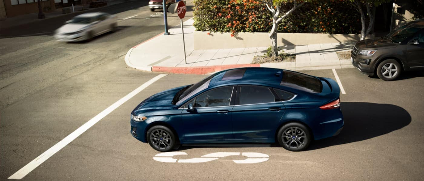 2020 Ford Fusion parked at a stop sign