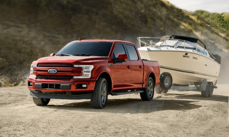 2020 Ford F-150 towing a boat on the beach