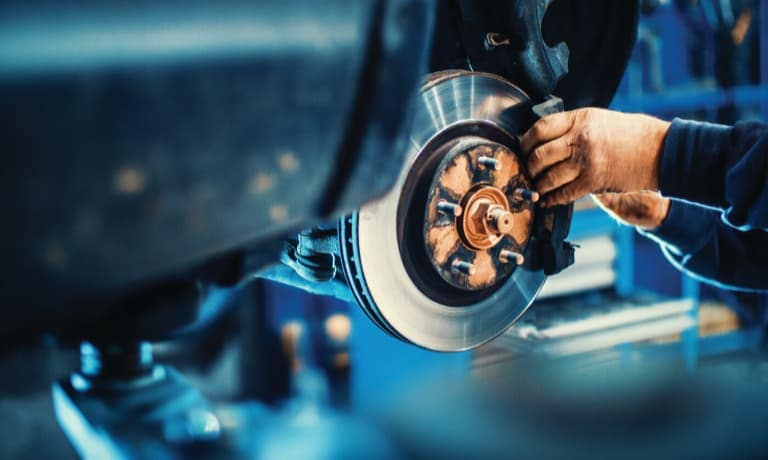 Man fixing car brakes
