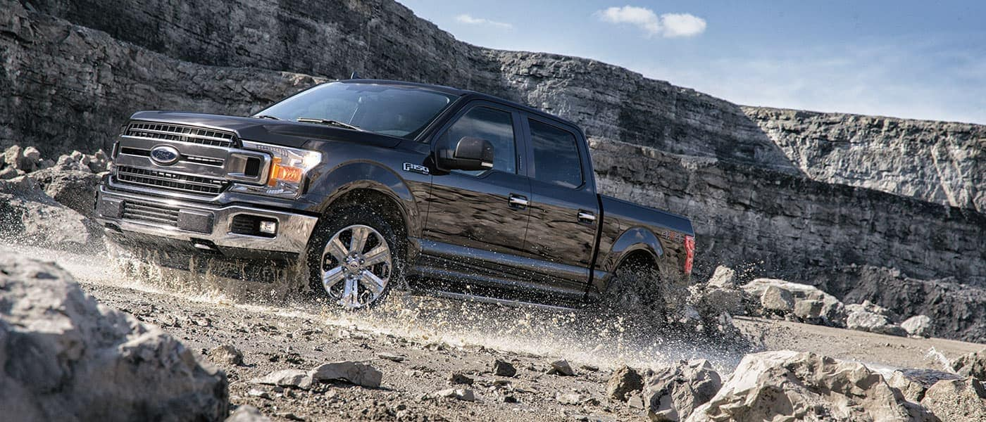 2019 Ford F-150 driving on rocks